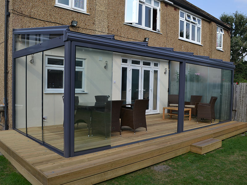 glass room on wooden patio