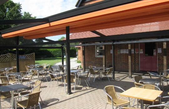 orange smoking area shelter