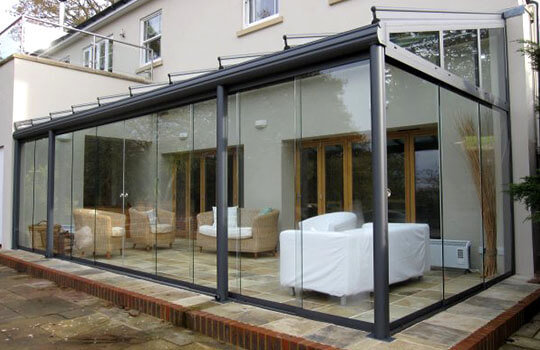 glass room on paved patio