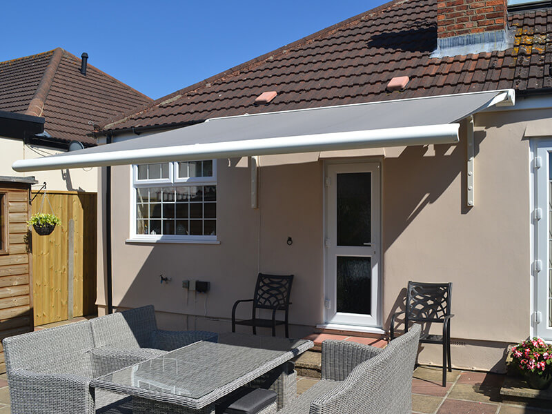 grey awnings providing protection for grey furniture