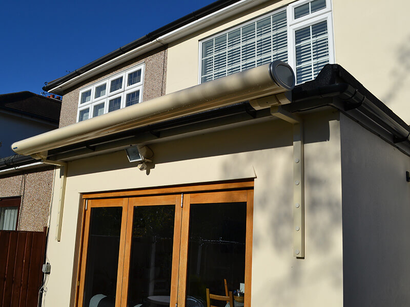 retracted awning in back garden