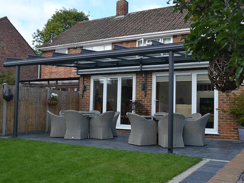 black frame glass awning in garden with artificial grass