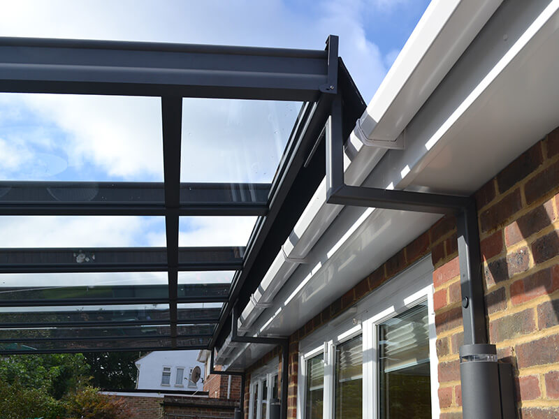 glass awning with black frame