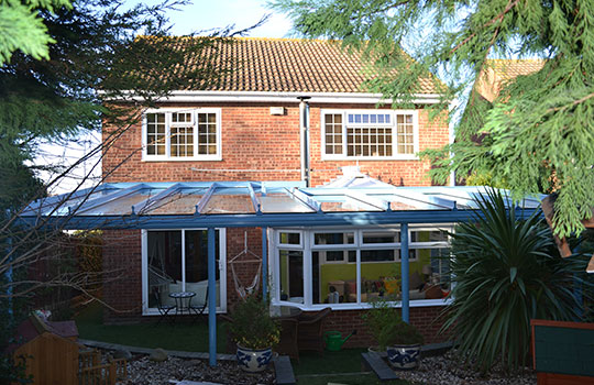glass dutch canopy in garden