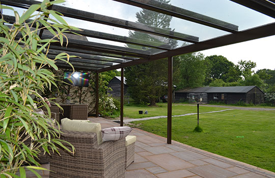 glass roof protecting patio